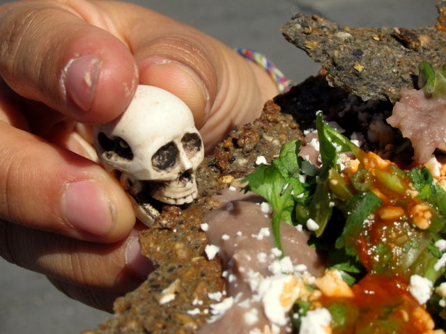 Little skull eating weird tortilla and cactus thing - Mexico City