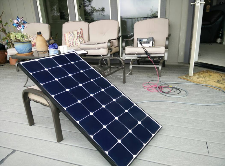 Hooking up our solar panel to the GoalZero for the first time